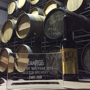 Buxton's trophy snuggles down in front of lots of lovely barrels.