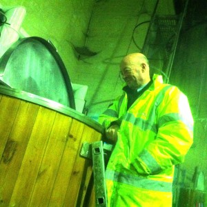 Mr. Stewart Main, Master Brewer,  looks at our creation with the smile of a man happy in his work.